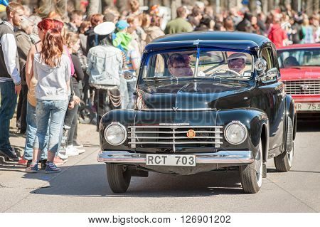 NORRKOPING, SWEDEN - MAY 1: Volvo PV 444 1947 at classic car parade celebrates spring on May 1, 2013 in Norrkoping, Sweden. This parade is an annual tradition in Norrkoping on May Day.