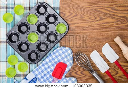 baking and cooking utensils on wooden table