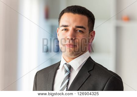 Confident young Latin American business man portrait