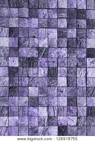Mosaic is of small square stone slabs of charoite