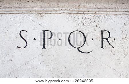 Roman symbol sign SPQR Italian architecture detail on white marble
