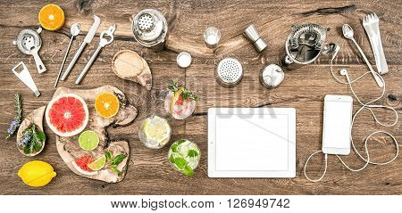 Food blogger desk with bar tools accessories and electronic devices. Flat lay background