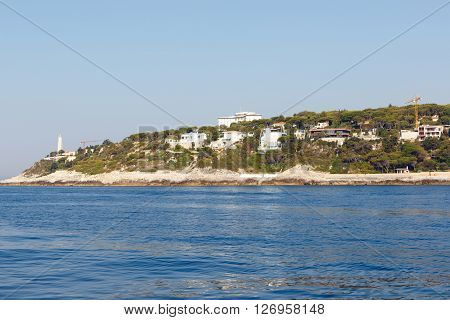 Color DSLR stock image of houses, apartments and condominiums along the Mediterranean coast of the French Riviera near Nice, France. Horizontal with copy space for text