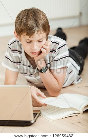 Young Student Doing His Schoolwork At Home
