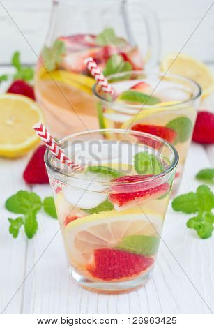 Strawberry mint homemade lemonade on white wooden table ** Note: Shallow depth of field