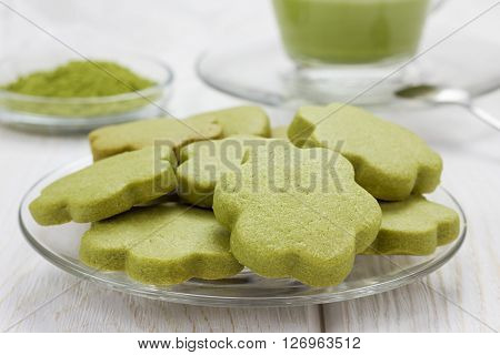 Homemade matcha green tea shortbread cookies on a glass plate
