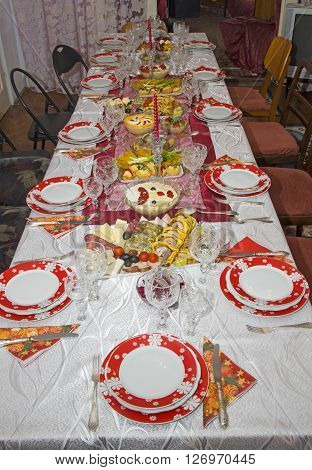 Christmas table settings with tasty food, cuisine pgoto