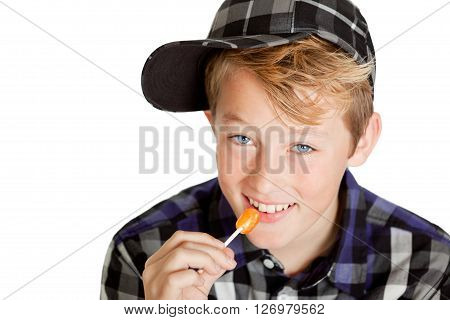 Cute Young Boy Eating A Lollipop