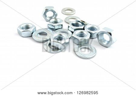 Several metal screw washers and nuts isolated on white background.
