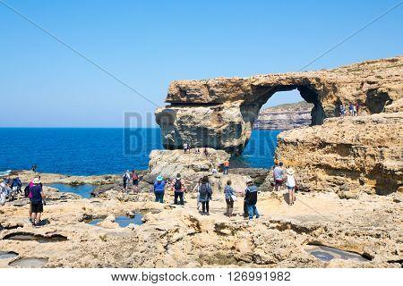 GOZO ISLAND, MALTESE ISLAND - NOVEMBER 5, 2015. People take photos of Azure Window, one of the most beautiful attraction of Gozo Island .