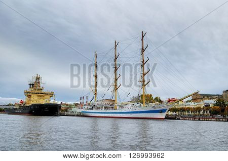 SAINT-PETERSBURG RUSSIA - OCTOBER 20 2012. Three-masted ship Mir and icebreaker Moscow at the pier on the Neva river.