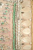 embroidered material with shells beads and sequins poster