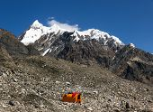 Base Camp of High Altitude Expedition at Mountains with Snow and Ice Summit Orange Bivouac with Sleeping Bags Drying on Roof of It poster