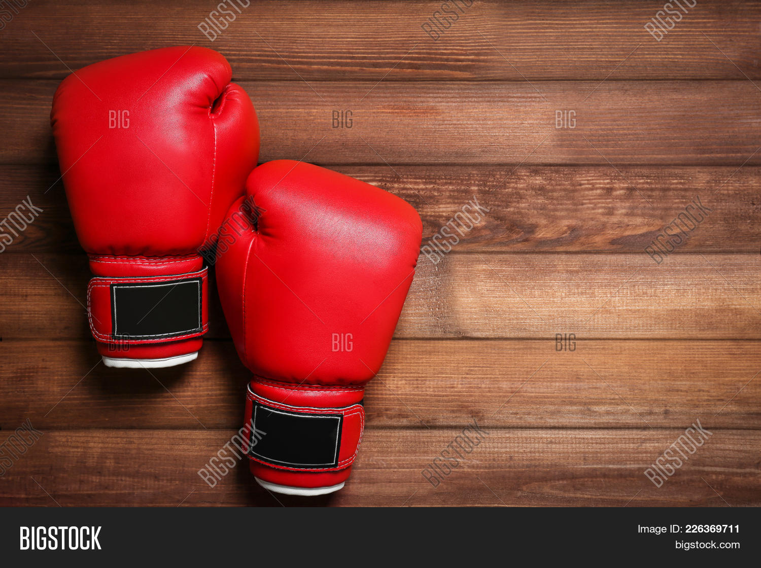 boxing gloves on wooden powerpoint template boxing gloves on