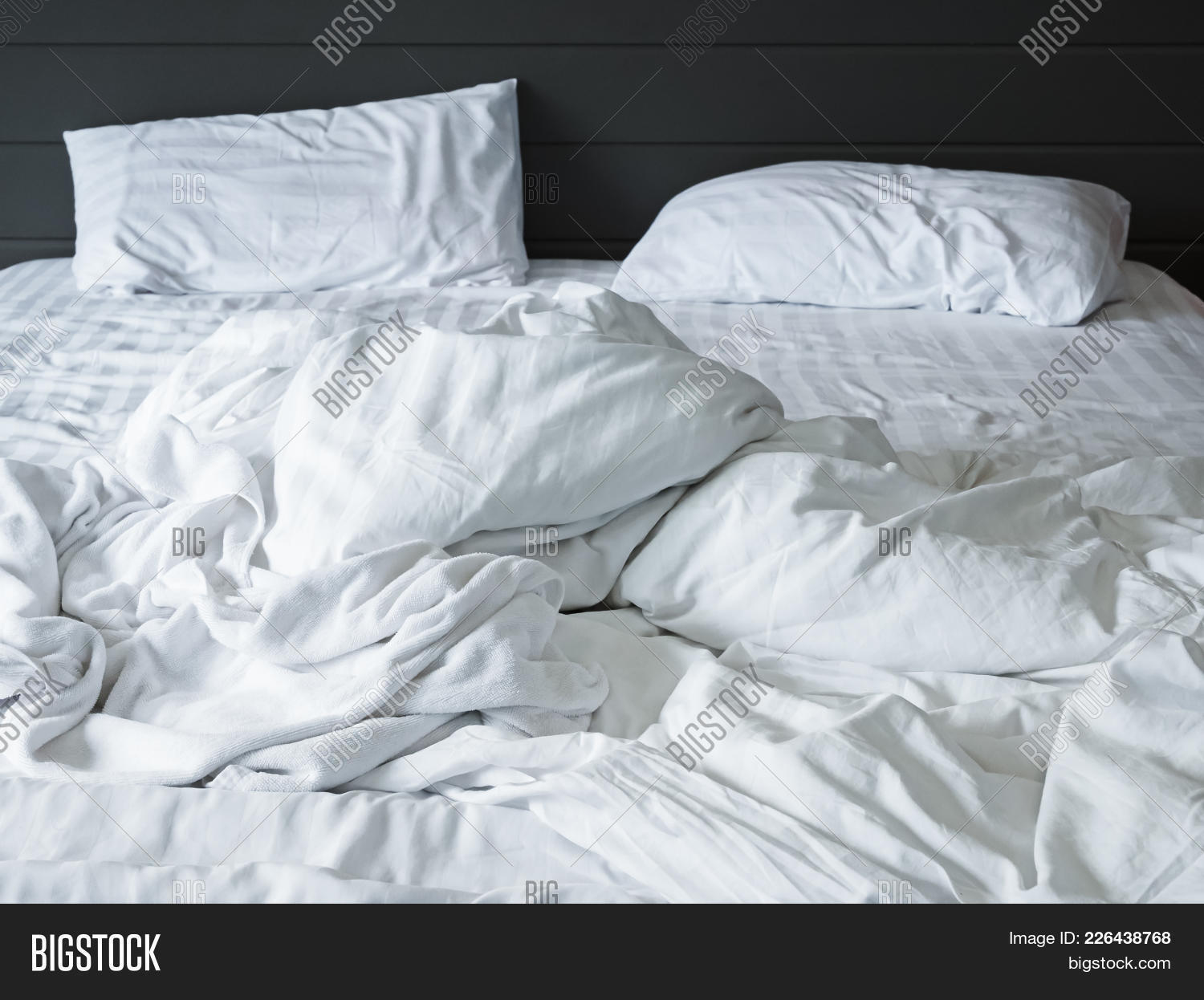 Messy White Bedding Sheets And Pillow In Bedroom Background , Unmade Messy  Bed After Comfort Sleep