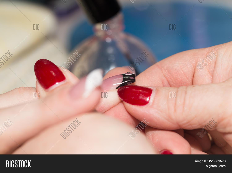 fingernail manicure in beauty salon powerpoint template fingernail