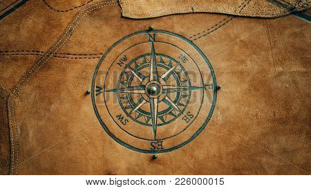 Compass North. Compass With Wind Rose, The Arrow Points To The West. Compass On A Blue Background. C