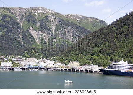 The View Of Juneau Downtown Surrounded By Mount Juneau And Roberts (alaska).