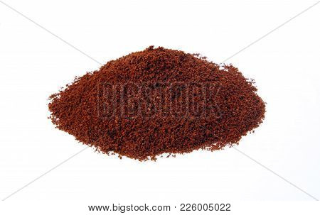 Brown Grains Of  Coffee On White Backgtround