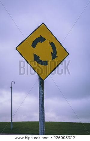 Close Up Of A Roundabout Road Sign