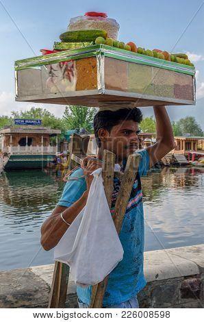 Srinagar, India - Julay 30, 2017: Tradesman In Srinagar, Zabarwan Mountain Valley, Who Transports Pr
