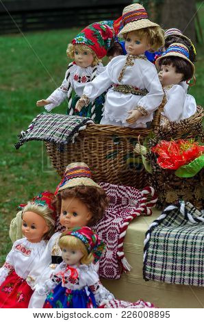 Dolls Dressed In Traditional Romanian Folk Costumes And Exposed For Sale At One Traditional Fair Of