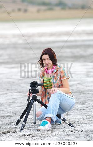 Young Woman Making A Film In The Salt Desert