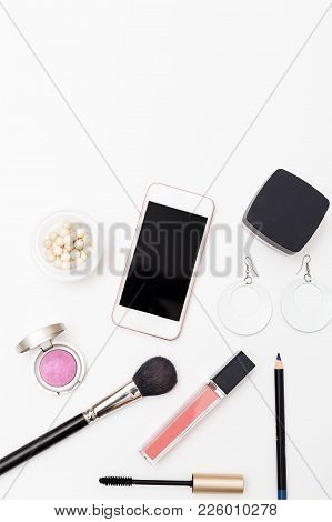 Make Up On A White Background And Phone On A White Background. Vertical Flat Lay
