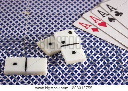 Domino And Four Aces On The Back Of Playing Cards Objects For Popular Table Games All Over The World