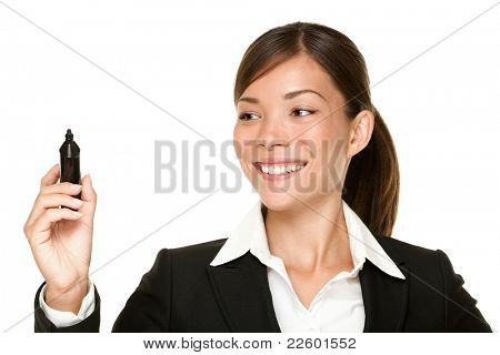 business woman writing with pen on virtual screen with copy space for text or design. Beautiful young smiling Asian / Caucasian professional isolated on white background.