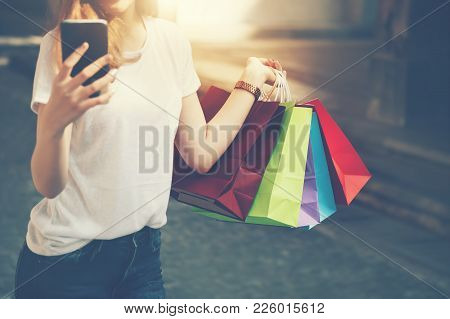 Shopping Mall. Happy Woman Holding Shopping Many Color Bag Enjoying In Shopping. Consumerism, Shoppi
