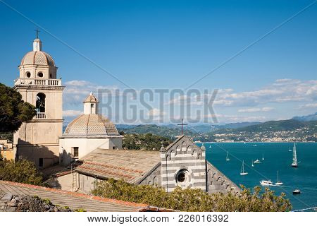 The St. Lawrence Church Of Portovenere In The La Spezia Province Of Liguria With A View On The Golf
