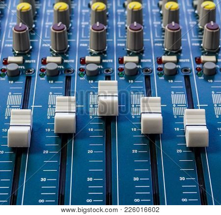 A Closeup Of The Faders On A Music Mixer As Used By A Sound Engineer