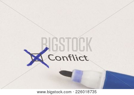 Questionnaire. Blue Marker And The Inscription: Conflict With Cross On The White Paper.