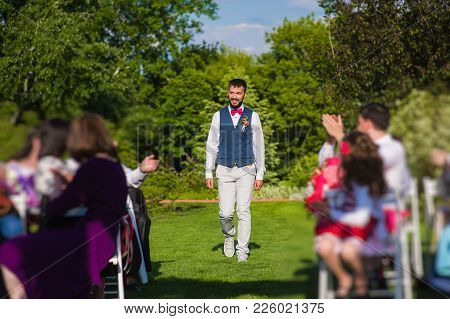 Handsome Future Husband Passing Clapping Handspeople, Invited For His Marriage During Wedding Ceremo