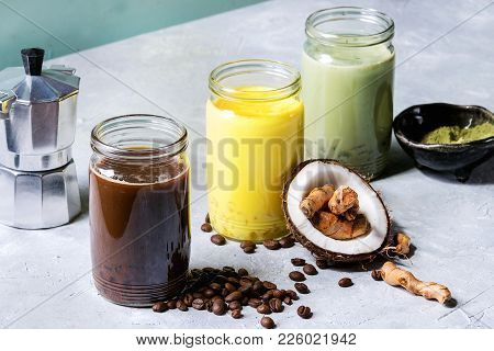 Variety Of Iced Colorful Latte Drinks. Iced Coffee, Turmeric And Matcha Latte Cocktails In Glass Jar
