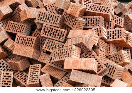 Group Of Bricks Square Construction Materials. Pile Of Red Bricks.