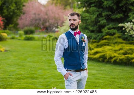 Just Married Man In Casual Look With A Beard, Blue Vest, Pink Velvet Tie-bow And Peony Boutonniere