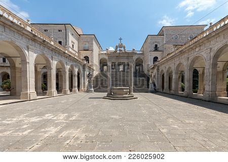 Montecassino, Italy - June 17, 2017: Cistern And Statues Of St. Benedict And St. Scholastica In The