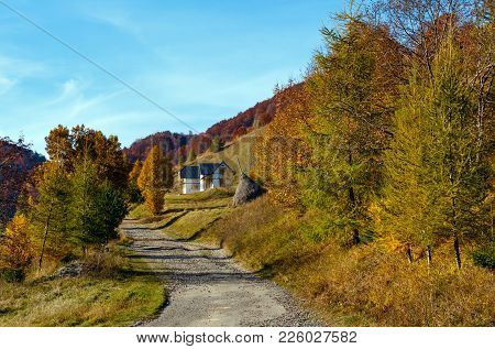 Dirty Secondary Road To Mountain Pass In Autumn Carpathians And Multicolored Yellow-orange-red-brown