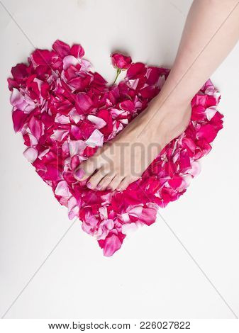 Pink Heart And Pink Nail Polish On White Background. Morning Of St. Valentine's Day. Pink Pedicure F