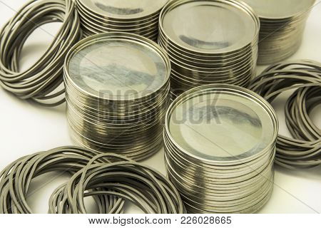 Tin lids isolated with rubber washers on white background, for closing of glass jars. Cover for cons