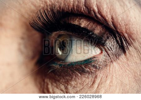 Old Woman Eye, Makeup For Older Women. Mascara And Blue Eyes With Wrinkles. Age-related Makeup. Old