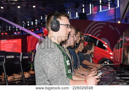 Cologne, Germany - August 24, 2017: Trade Fair Visitors Playing The Project Cars 2 Game At Gamescom