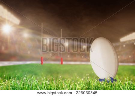 White Rugby Ball On A Kicking Tee On The Grass Ready For Conversion Or Penalty Kick Toward Goal Post