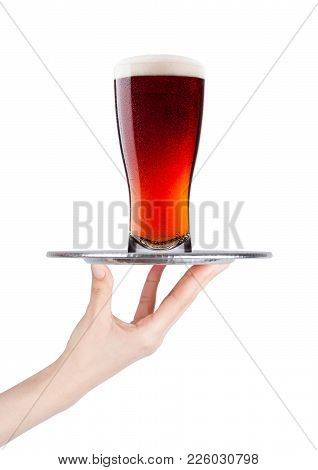 Hand Holds Tray With Cold Red Ale Beer With Foam On White Background