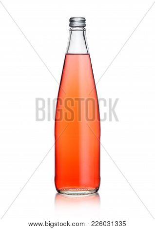 Glass Bottle Of Sparkling Pink Soda Lemonade On White Background With Reflection