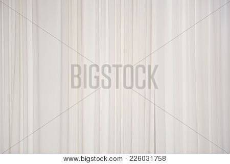 White Soft Fabric Background. Draped Curtain Hanging On The Window Close-up. Empty Texture. Web Bann