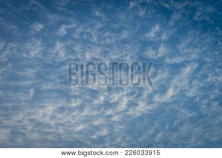 Clouds In The Shape Of Angels Float Across A Blue Sky In Malaga, Spain, Europe