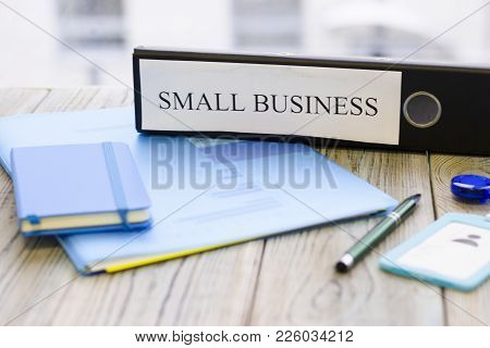 Planning Business Concept - Small Business Documents, Notepad And A Pen. Rough Bords Background. Clo